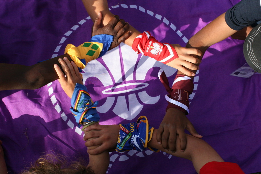 Scouts from different  regions and cultures symbolically join hands to Create a Better World