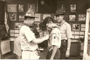 Japanese Scouts visit Cheng Yuan High School's Scout troop. From the right, principal Mr. Dai-Xiang Li, patrol leader Mr. Xing-He Tian and the Japanese Scoutmaster.  This photo was taken on 8 May 1967.