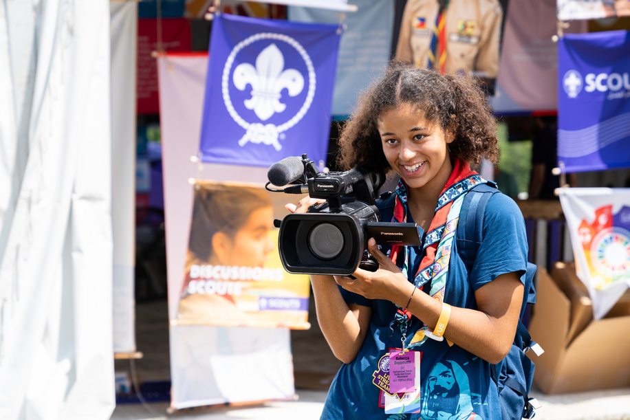 Young Scout using video camera. 24th World Scout Jamboree, North America, in West Virginia. July 2019.