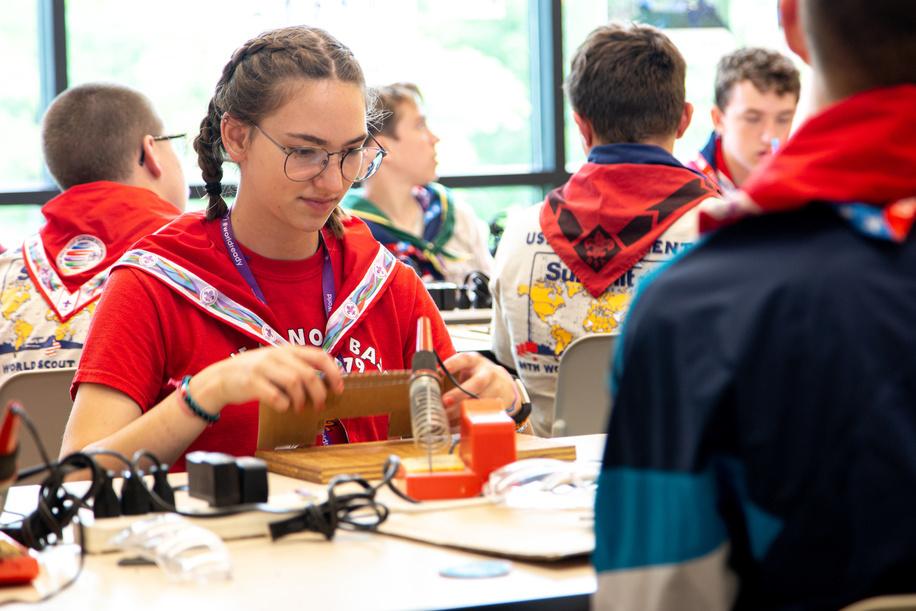 Girl scout in robotics workshop during Jamboree