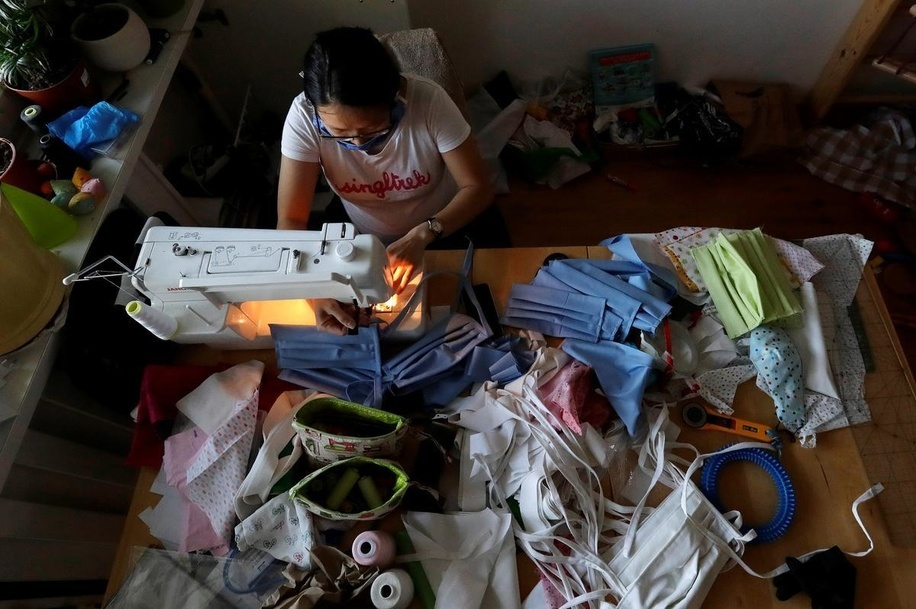 Hong Nhung Strnadova sews pieces of clothes to make face masks at her apartment as a protection from the new coronavirus disease (COVID-19) in Prague, Czech Republic, March 17, 2020.