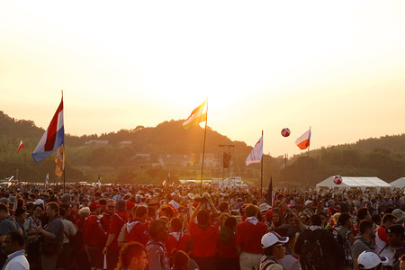 Sun setting over the main arena as participants move into the area