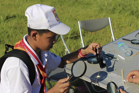 The scout make fire using glass during Global Development Village activities. #wsj2015